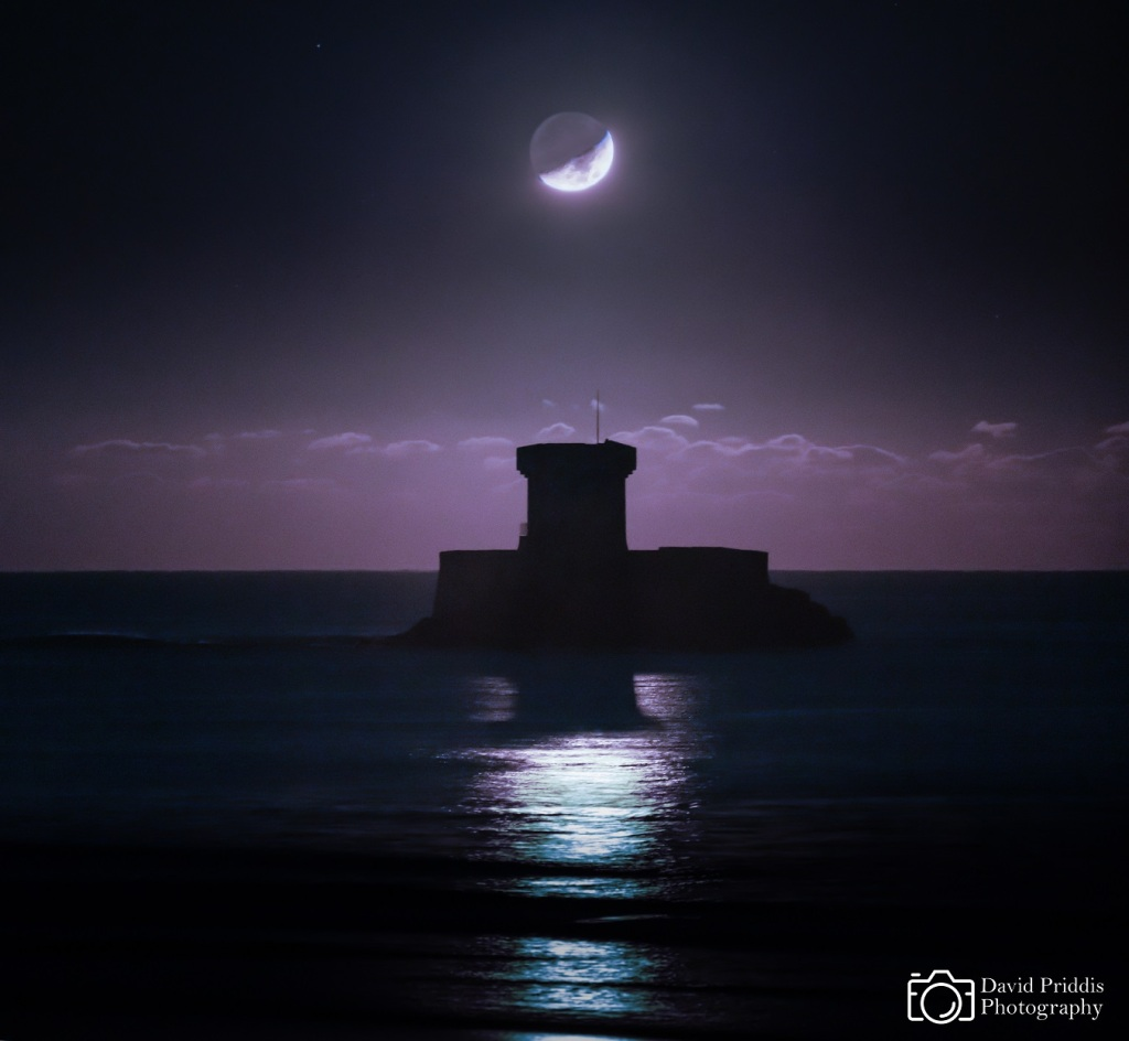 Moon setting over La Rocco Tower, Jersey.